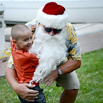Juda Ayala, 6, of Phoenix, Ariz., hugs Santa during Vermilion's annual Christmas in July festivities on July 25.  KRISTIN BAUER | CHRONICLE
