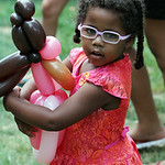 Selena Shepherd, 3, of Elyria, hugs her balloon princess creation during the annual Voices for Children Family Fun day at Ely Square in Elyria on July 20. ANNA NORRIS/CHRONICLE