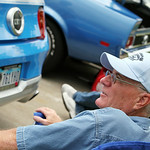 Joe Leybig talks about his 2012 Ford Mustang GT with a spectator during the annual Mustang and Ford Show at Nick Abraham's Ford in Elyria Sunday afternoon. ANNA NORRIS/CHRONICLE