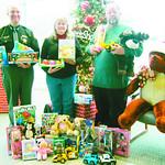 Sheriff Phil Stammitti, President of Ohio Kiwanis Foudnation Kathryn Karpus, and President of Elyria Kiwanis Stan Wojdyla donate toys on behalf of Elyria Kiwanis.