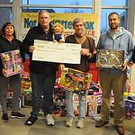 Elyria Browns Backers, from left, Ray and Rhonda Edwards, Dennish Baluh, president, John Kasper, Bill Hudnutt and Judi Hudnutt made a donation to the Not Forgotten Box on Dec. 9.