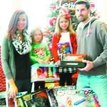 Tina, Lexi, 3, Mia, 5, and Bob Vandemark make sure to donate every year on behalf of Vandemark Jewelers.