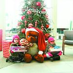Gabriella Crock, 3, and Emma Adkins, 6, of Wellington donate toys.