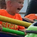 Colson Lutz, 4, of Wakeman takes a ride on the dragon coaster.
