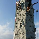Josiah Bennett, 5, climbs the rock wall.