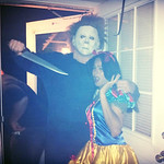 Paul pretends to hold his wife, Aileen, hostage as part of their Halloween costumes.