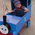 Preston Madding, 3, is the conductor of the Thomas the Tank Engine wagon his grandfather built him.