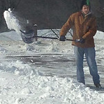 Tyler, 14, shovels in Chris Cousino Dunham's North Ridgeville neighborhood.