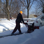 Austin, 16, shovels in Chris Cousino Dunham's North Ridgeville neighborhood.