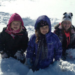 Lauren Stefek, Hailey Wade and Abbey O'Donnell play in the snow on Jan. 3.