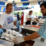 Taso Koutsaftis, of Amherst, Bill Tsardoulias, of Elyria, and Alex Karas, of Lorain, prepare gyros for sale at the annual St. Nicholas Greek Orthodox Church Greek Festival on Sept. 5. KRISTI …