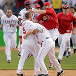 Los Angeles Angels' Jeff Mathis (5) is congratulated by teammates after hitting a double to score Howie Kendrick to beat the Yankees 5-4 in the eleventh inning of Game 3 of the American Leag …