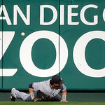 New York Yankees' Nick Swisher can't come up with a triple hit by Los Angeles Angels' Howie Kendrick during the seventh inning of Game 3 of the American League Championship baseball series M …