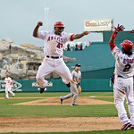 Los Angeles Angels' Howie Kendrick (47) celebrates with Erick Aybar (2) after scoring the game-winning run on a double by Jeff Mathis during the 11th inning of Game 3 of the American League  …