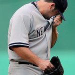 New York Yankees' Joba Chamberlain reacts after giving up a run during the seventh inning of Game 3 of the American League Championship baseball series against the Los Angeles Angels Monday, …