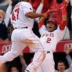 Los Angeles Angels' Howie Kendrick (47) is congratulated by Erick Aybar (2) after scoring on a double by Jeff Mathis during the 11th inning of Game 3 of the American League Championship base …