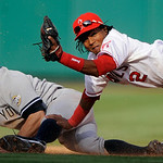 Los Angeles Angels' Erick Aybar (2) tags to New York Yankees' Brett Gardner as Gardner is caught stealing second during the eighth inning of Game 3 of the American League Championship baseba …