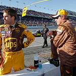 David Ragan, left, talks with a crew member during a red flag in the NASCAR Daytona 500 auto race at Daytona International Speedway in Daytona Beach, Fla., Sunday, Feb. 14, 2010. (AP Photo/T …