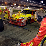 Crew members perform a pit stop on driver Kevin Harvick's car during the NASCAR Daytona 500 auto race at Daytona International Speedway in Daytona Beach, Fla., Sunday, Feb. 14, 2010. (AP Pho …