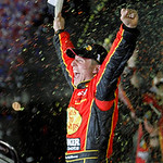 Jamie McMurray reacts in victory lane after winning the NASCAR Daytona 500 auto race at Daytona International Speedway in Daytona Beach, Fla., Sunday, Feb. 14, 2010. (AP Photo/Don Montague)