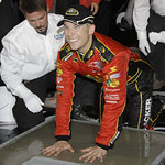 Jamie McMurray places his hands in concrete for display at Daytona International Speedway after winning the NASCAR Daytona 500 auto race in Daytona Beach, Fla., Sunday, Feb. 14, 2010. (AP Ph …