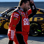 Driver Tony Stewart walks down pit road during a red flag delay in the Daytona 500 NASCAR auto race at Daytona International Speedway in Daytona Beach, Fla., Sunday, Feb. 14, 2010.(AP Photo/ …
