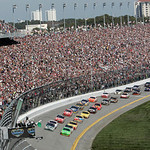 Drivers take the green flag for the start of the NASCAR Daytona 500 auto race at Daytona International Speedway in Daytona Beach, Fla., Sunday, Feb. 14, 2010. (AP Photo/David Graham)