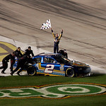Kurt Busch celebrates a win at the NASCAR Sprint Cup Series auto race  at Texas Motor Speedway on Sunday, Nov. 8, 2009, in Fort Worth, Texas. (AP Photo/Mike Fuentes)