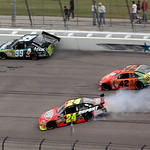 Jeff Gordon (24) skids while trying to avoid cars after Juan Pablo Montoya (42), of Colombia, tapped Carl Edwards (99), sending Edwards against the wall, during the NASCAR Sprint Cup Series  …