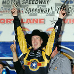 Kurt Busch celebrates after winning the NASCAR Sprint Cup Series auto race at Texas Motor Speedway on Sunday, Nov. 8, 2009, in Fort Worth, Texas. (AP Photo/Larry Papke)