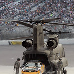 Space shuttle Endeavour pilot Doug Hurley drives the pace car out of a Chinook helicopter before the NASCAR Sprint Cup Series auto race at Texas Motor Speedway on Sunday, Nov. 8, 2009, in Fo …