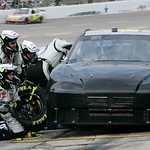 Crew members change tires on Jimmie Johnson's car during the NASCAR Sprint Cup auto race at Texas Motor Speedway, on Sunday, Nov. 8, 2009, in Fort Worth, Texas. Johnson crashed on the third  …
