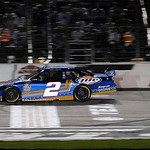 Kurt Busch crosses the finish line for the win in the NASCAR Sprint Cup Series auto race at Texas Motor Speedway on Sunday, Nov. 8, 2009, in Fort Worth, Texas. (AP Photo/Larry Papke)