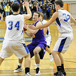 Avon RJ Kauffman is tied up trying to squeeze between Midview 34 Riley Moore and 32 Patrick Linn Feb. 15.  Steve Manheim