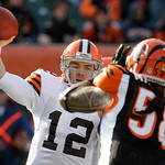 Cleveland Browns quarterback Colt McCoy (12) passes under pressure from Cincinnati Bengals linebacker Rey Maualuga (58) in the first half of an NFL football game, Sunday, Dec. 19, 2010, in C …