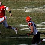 Kansas City Chiefs quarterback Matt Cassel (7) runs past Cleveland Browns linebacker Jason Trusnik for a short gain during the first quarter of an NFL football game Sunday, Dec. 20, 2009, in …