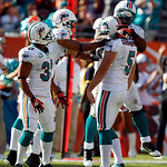 Miami Dolphins placekicker Dan Carpenter (5) is congratulated by running back Lousaka Polite, right, after kicking a 60-yard field goal in the second quarter during an NFL football game agai …