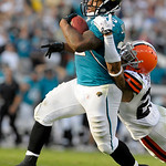 Jacksonville Jaguars running back Maurice Jones-Drew, left, is tackled from behind by Cleveland Browns cornerback Joe Haden after a 75-yard run during the second half of an NFL football game …