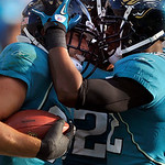 Jacksonville Jaguars safety Sean Considine (37) and Jacksonville Jaguars cornerback Don Carey (22) celebrate an interception in the final second of an NFL football game against the Cleveland …