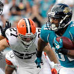 Jacksonville Jaguars wide receiver Mike Thomas (80) tries to get around Cleveland Browns safety Nick Sorensen (27) after catching a pass in the first half of an NFL football game in Jacksonv …