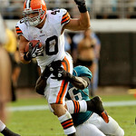 Cleveland Browns running back Peyton Hillis (40) is tackled by Jacksonville Jaguars linebacker Justin Durant (56) during the second half of an NFL football game, Sunday, Nov. 21, 2010, in Ja …