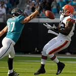 Cleveland Browns tight end Benjamin Watson (82), right, bobbles a pass as Jacksonville Jaguars safety Sean Considine (37) comes and intercepts the ball during the second half of an NFL footb …