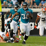 Jacksonville Jaguars running back Maurice Jones-Drew (32), center, breaks free from Cleveland Browns cornerback Raymond Ventrone (41), left, and Eric King (30) for a 75-yard run during the s …