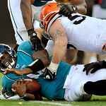 Jacksonville Jaguars quarterback David Garrard (9) is sacked by Cleveland Browns linebacker Matt Roth (53) during the second half of an NFL football game, Sunday, Nov. 21, 2010, in Jacksonvi …