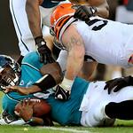 Jacksonville Jaguars quarterback David Garrard (9) is sacked by Cleveland Browns linebacker Matt Roth (53) during the second half of an NFL football game, Sunday, Nov. 21, 2010, in Jacksonvi …