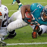Jacksonville Jaguars running back Maurice Jones-Drew (32) scores the winning touchdown on a one-yard run past Cleveland Browns safety Abram Elam (26) during the fourth quarter of an NFL foot …