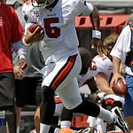 Tampa Bay Buccaneers quarterback Josh Freeman (5) sprints past Cleveland Browns linebacker Eric Barton (50) on a 33 yard first quarter run during an NFL football game Sunday, Sept. 12, 2010, …