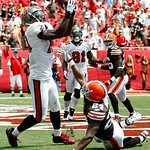 Tampa Bay Buccaneers wide receiver Mike Williams (19, left) pulls in a three-yard, second quarter, touchdown pass in front of Cleveland Browns cornerback Sheldon Brown (24) during an NFL foo …