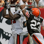 Tampa Bay Buccaneers wide receiver Micheal Spurlock (81, left) pulls in what proved to be the game winning touchdown pass in front of Cleveland Browns cornerback Joe Haden during the fourth  …