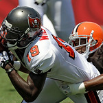 Tampa Bay Buccaneers wide receiver Mike Williams (19) gets dragged down by Cleveland Browns cornerback Sheldon Brown (24) after a nine-yard first quarter reception during an NFL football gam …